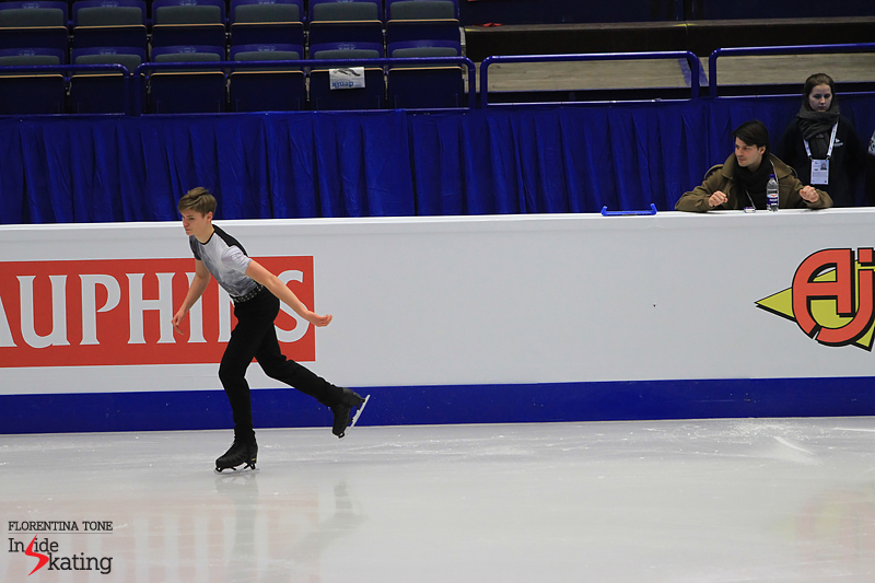 Clenched, confident fists for a remarkable young man – Deniss Vasiljevs takes the ice for his short program in Ostrava