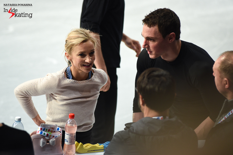 The highlight of group 3 of practice is, of course, this pair: Aliona Savchenko and Bruno Massot; here you have them at the boards, talking to their coaches, Alexander König and Jean-Francois Ballester.