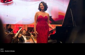 Khatia Buniatishvili. Colour: red